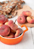 Peach figs in a ceramic bowl on a white background. Peach figs in a ceramic bowl Royalty Free Stock Image