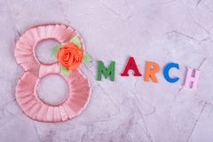 Peach figure eight and word March. Beautiful handmade figure and words. Make the woman smile Royalty Free Stock Image