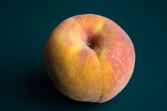 Peach. Fresh peach on neutral background Royalty Free Stock Photography