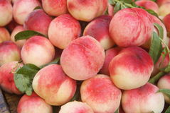Peach. Fresh peaches are on sale in the market. Peach close-up Royalty Free Stock Photo