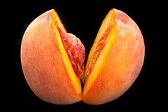 Peach fruit on black Royalty Free Stock Photo