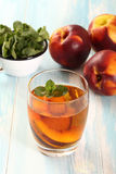 Peach  fruit cocktail in glass Royalty Free Stock Photography