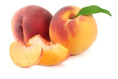 Peach fruit with green leaf and slices isolated on white background royalty free stock photo