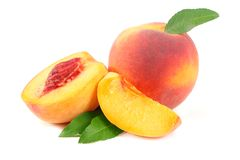 Peach fruit with green leaf and slices isolated on white background stock images