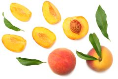 Peach fruit with green leaf and slices isolated on white background. top view royalty free stock photography