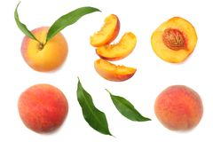 Peach fruit with green leaf and slices isolated on white background. top view royalty free stock photos