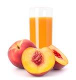 Peach fruit juice in glass Stock Photos