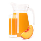 Peach fruit juice in glass jug Royalty Free Stock Images