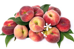 Peaches with leafs isolated Stock Image
