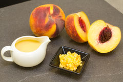 Peach fruit, pulp and peach cream for some gourmet recipe Royalty Free Stock Photography