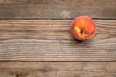 Peach fruit on weathered wood Stock Photography