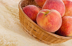 Peach fruits in a basket Stock Image