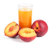 Peach fruits and glass of juice Royalty Free Stock Photography
