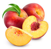 Peach fruits isolated. Peach fruits with green leaf isolated on white background Stock Images