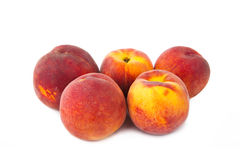Peach fruits isolated on white Stock Photos