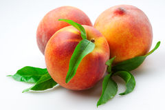 Peach. fruits with leaves. Isolated on white Royalty Free Stock Photography
