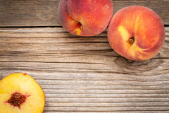 Peach fruits on weathered wood Stock Images