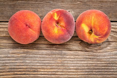 Peach fruits on weathered wood Royalty Free Stock Photography
