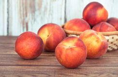 Peach fruits on wooden table Stock Photography