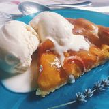 Peach galette with lavander ice cream Royalty Free Stock Images