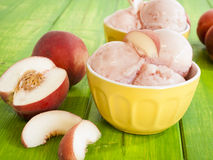 Peach Gelato. Gelato is made with milk, cream, various sugars, and flavoring such as fresh fruit and nut purees Royalty Free Stock Photography
