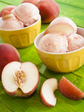 Peach Gelato. Gelato is made with milk, cream, various sugars, and flavoring such as fresh fruit and nut purees Royalty Free Stock Image
