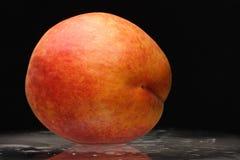 Peach on the glass Stock Photos