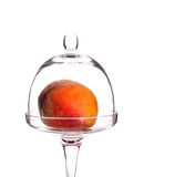Peach in the glass bowl. Mellow succulent peach in the glass bowl Stock Image