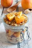 Peach granola overnight breakfast oats on white wood Royalty Free Stock Photo