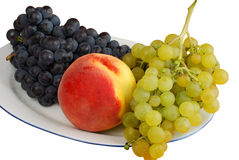 Peach and grape. Peach and bunch on the plate isolated on white background Royalty Free Stock Photo