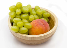 Peach and grapes Stock Images