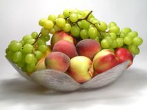 Peach and green grapes Royalty Free Stock Photos