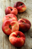 Peach group on wood table kitchen Royalty Free Stock Images