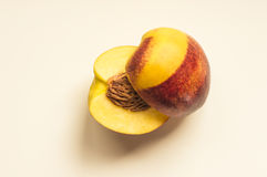 Peach in half. Ideal for wallpapers. Could be useful in presentations, web and printing design Stock Photography