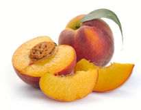 Peach and a half and leaves Stock Image