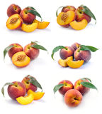 Peach and a half and leaves Stock Photos