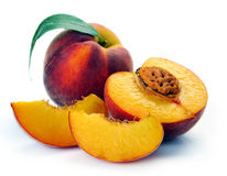 Peach and a half and leaves Royalty Free Stock Image