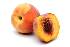 Peach and half peach. White background royalty free stock images