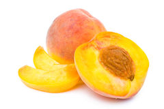 Peach with half and slices Royalty Free Stock Images