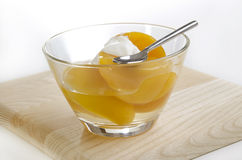 Peach half with yoghurt Royalty Free Stock Photography