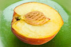 Peach Halve on a Plate Royalty Free Stock Images