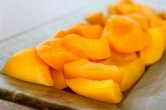 Peach halves in light syrup Stock Photos
