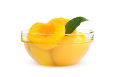 Peach halves in syrup Royalty Free Stock Images