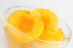 Peach halves in syrup. Peach halves in light syrup Royalty Free Stock Image