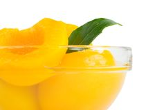 Peach halves in syrup Stock Image