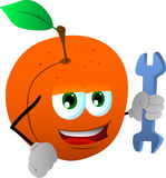 Peach handyman holding a wrench Royalty Free Stock Image