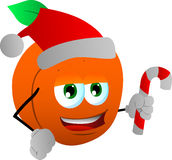 Peach holding a candy cane and wearing Santa's hat Royalty Free Stock Image