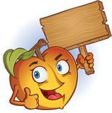 Peach Holding Sign Royalty Free Stock Photo