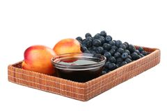 Peach, honey and blueberry Stock Photos