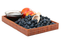 Peach, honey and blueberry Stock Photos